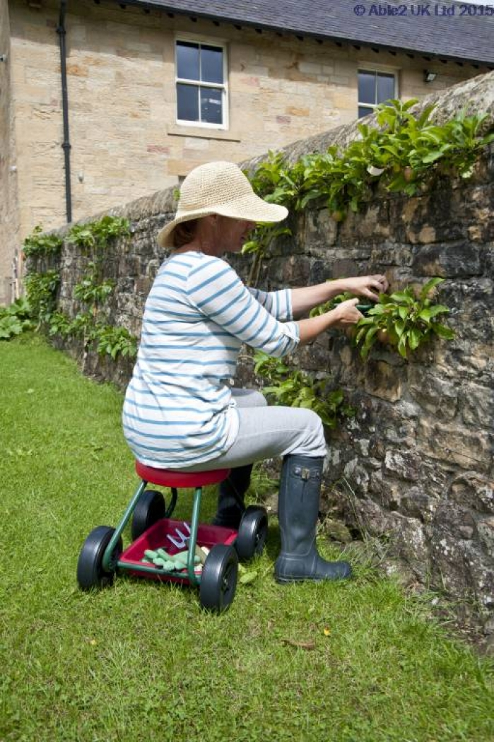 Woman using a rolling garden seat